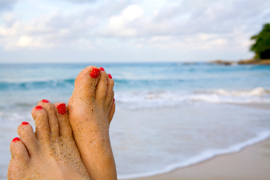 Woman's feet on the beach
